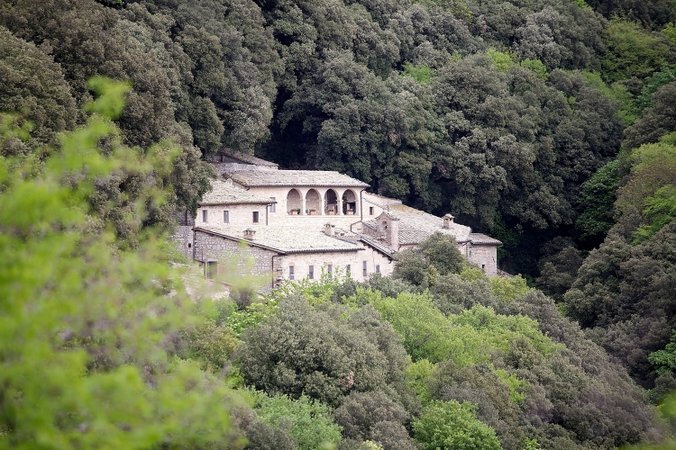 Eremo delle Carceri, Mount Subasio, Umbria, Italy. The Eremo delle Carceri is a small hermitage in a steep forest gorge at the Mount Subasio, four kilometres from Assisi. The word Carceri is from latin carceres and means isolated places. In the 13th century Saint Francis of Assisi returned here during his life to pray.