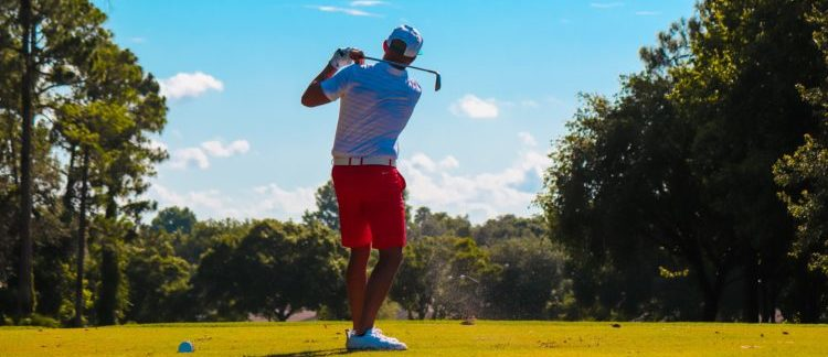 man playing golf on a sunny day
