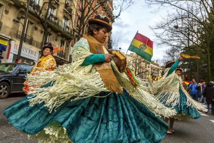 mardi gras festival france | Paris, France - February 11,2018: Bolivian female dancers performing in the street during the Carnaval de Paris 2018.