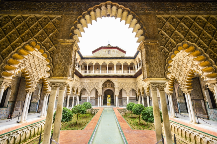 things to do in andalusia | SEVILLE, SPAIN - CIRA 2014: The Royal Alcazar of Seville at the Courtyard of the Maidens. It is the oldest royal palace still in use in Europe.