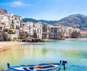 Old Harbour with fishing boat in Cefalu