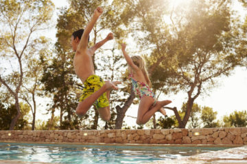 kids jumping in pool - family friendly ibiza