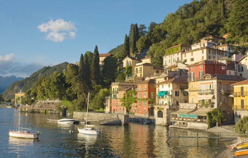 Hillside village of Varenna on the east shore of Lake Como, Italy, with boats just off the waterfront | Italian Lakes