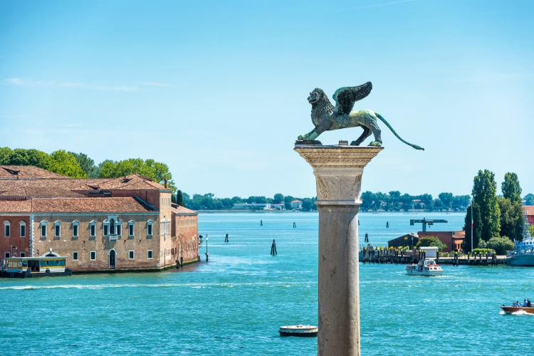 The famous ancient winged lion sculpture on the Piazza San Marco in Venice, Italy. The lion is a symbol of Venice.