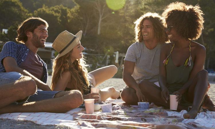 four friends on beach