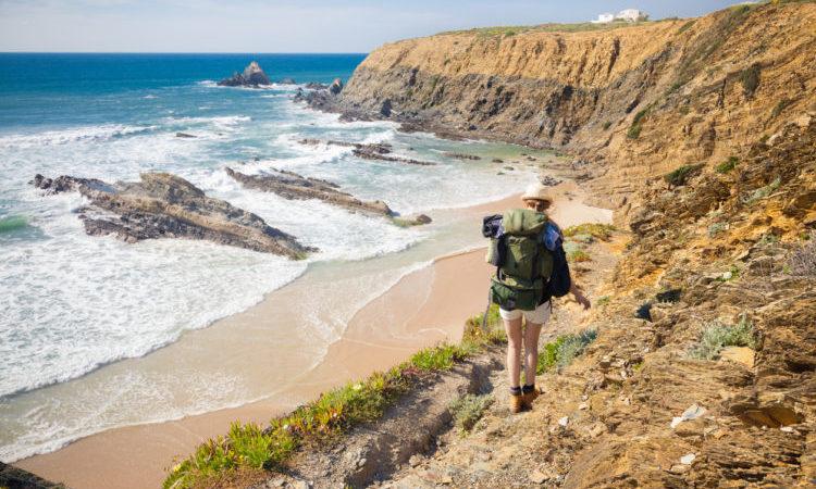 hiker on hiking trail along coast portugal , rota vicentina. HDR image