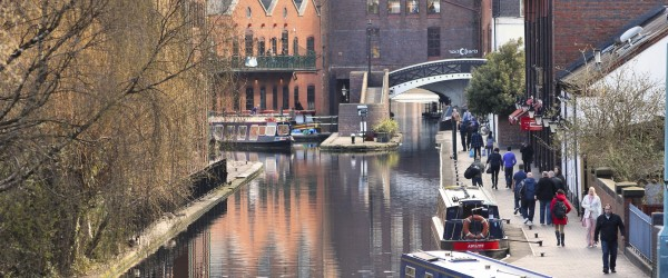 BIRMINGHAM, UK - APRIL 19, 2013: People visit Gas Street Basin in Birmingham, UK. Birmingham is the 2nd most populous British city. It has rich waterway and boat culture.