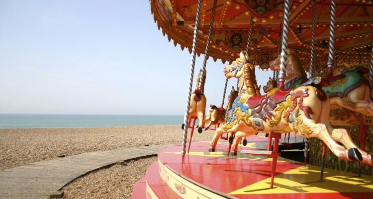 BRIGHTON, ENGLAND, JANUARY 1: Merry-go-round on Brighton beach with blue sky. United Kingdom 2006