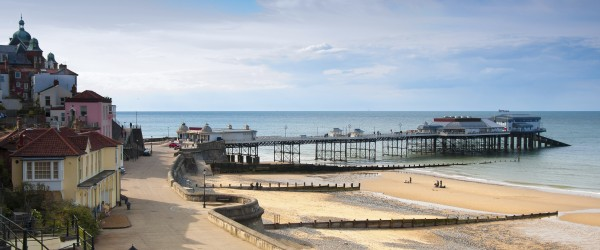 A view of promenade, town centrem, and pier, Cromer, seaside town in Norfolk, England