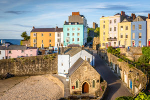 Pastel Coloured Town Houses overlooking the Harbour at Sunset. Tenby, Wales, UK.