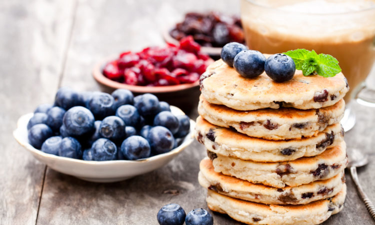 Stack of welsh cakes with blueberry and a cup of coffee