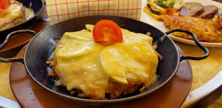 Traditional Welsh dish made with savory sauce of melted cheese poured over toasted bread served in a chafing dish.