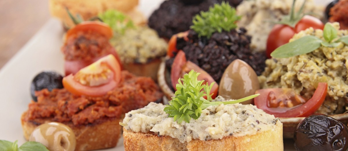 assortment of olive spread and toast