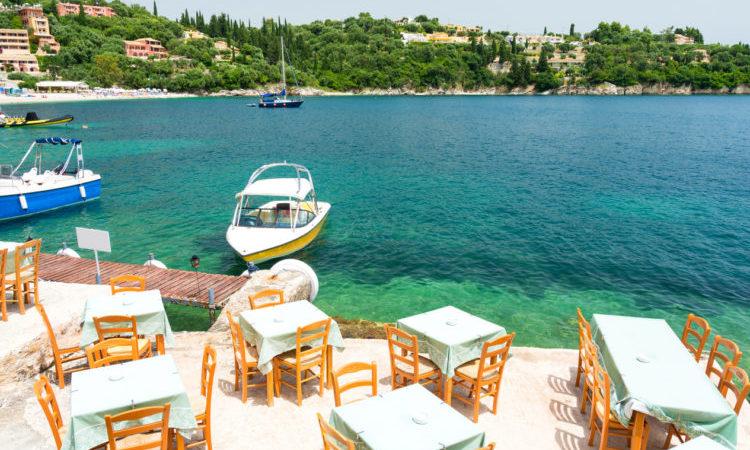 greek tavern over beautiful bay in Kalami in Corfu island, Greece