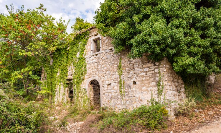 Old abandoned stone-built house in Old Perithia