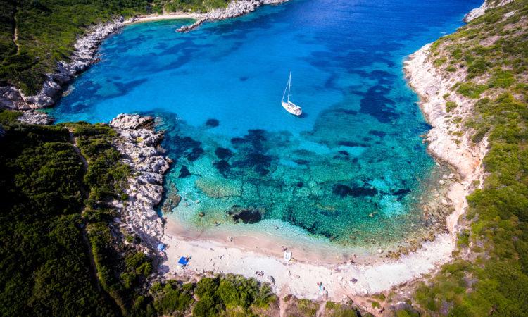 Porto Timoni, on of the hidden beaches of Corfu Island, also known as Kerkyra, near Agios Giorgios beach. Turqoise waters, summer aerial view from drone.