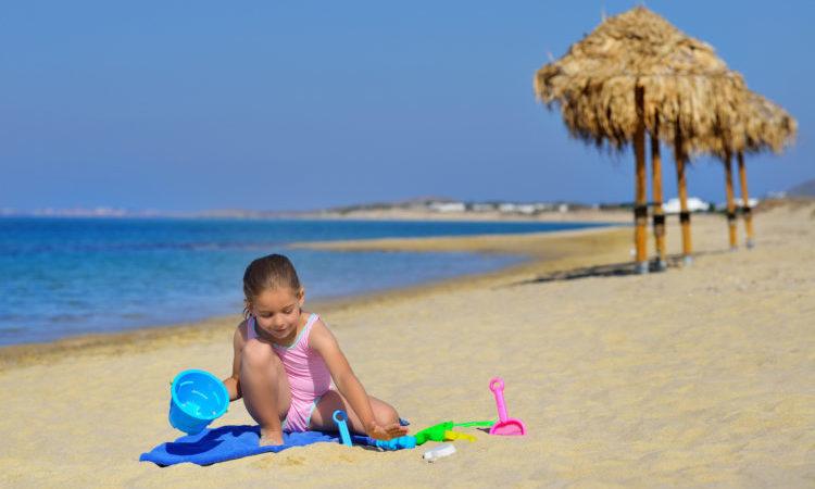 toddler girl enjoying her summer vacation at beach