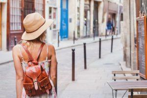 woman tourist on the street, summer fashion style, travel to Europe