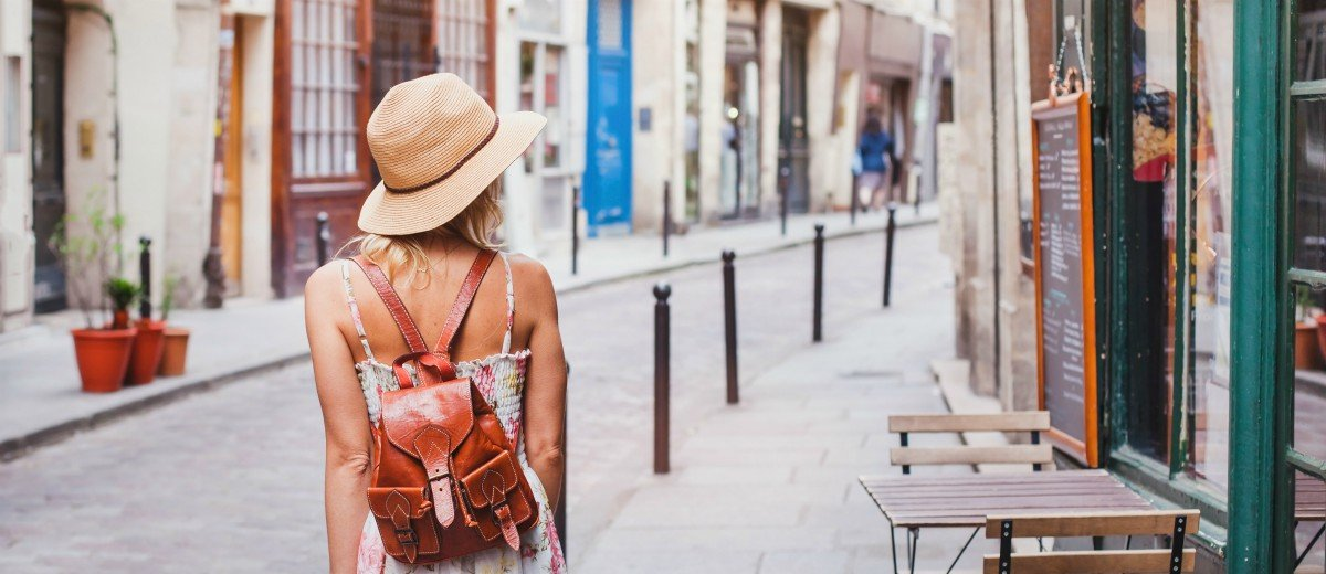 woman tourist on the street, summer fashion style, travel to Europe