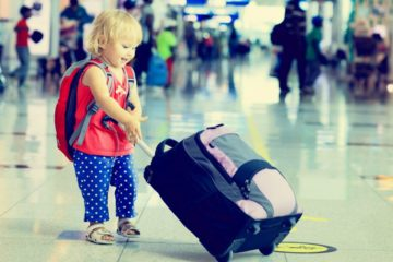 little girl with suitcase travel in the airport, kids travel