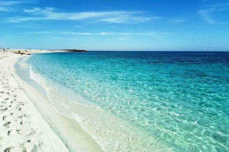 beaches in sardinia | white sand beach and blue water under clear sky | is aruttas