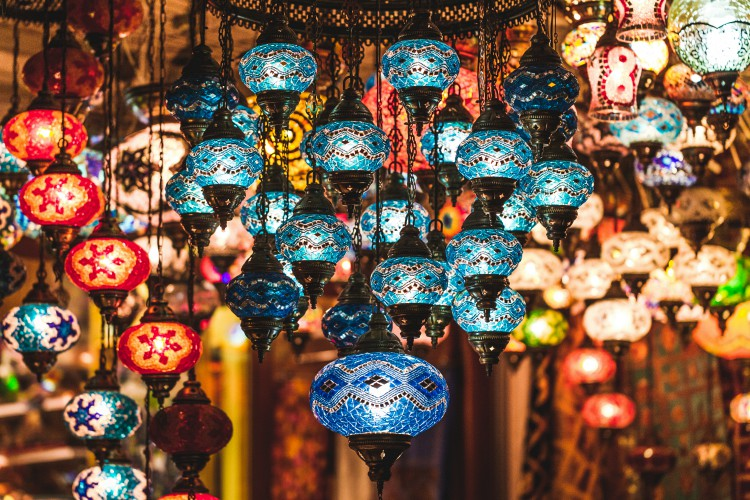 Amazing traditional handmade turkish lamps in souvenir shop. Mosaic of colored glass. Lit in the evening, creating a cozy atmosphere