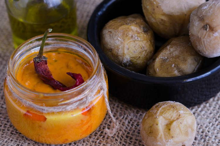 Local Canary Islands dish, Papas Arrugadas (wrinkly potatoes) with Mojo picon (red sauce).