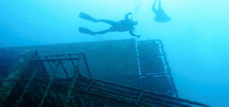 Scuba dive an underwater shipwreck