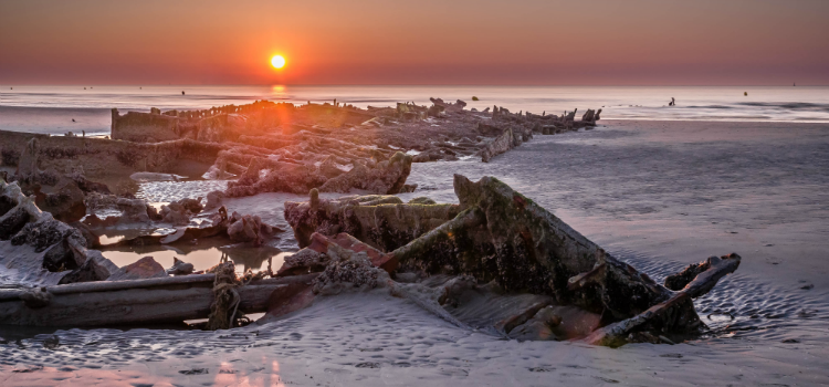 Remains of HMS Crested Eagle on Dunkirk beach, destroyed during WWII