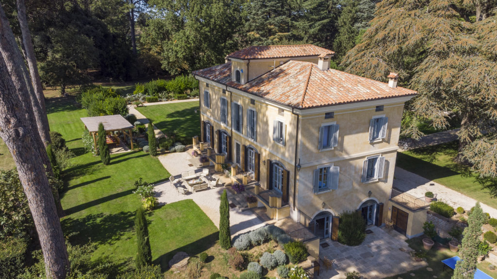 Italian villa from birds eye view with gardens