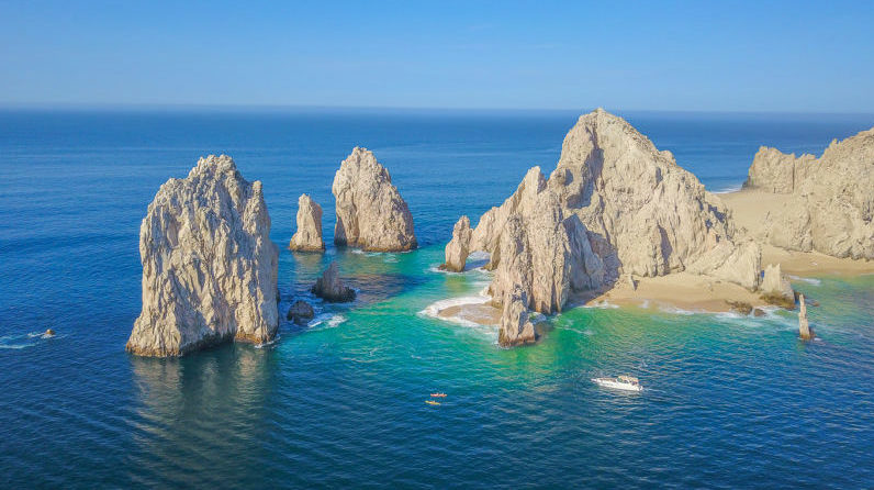 Aerial drone picture of cliffs, sand and emerald green water inin Cabo San Lucas