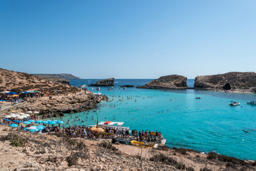 Blue Lagoon - Island of Comino - Malta. The Blue Lagoon on the tiny island of Comino with Gozo in the distance