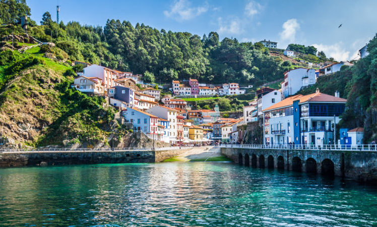 Fishing village in Asturias from the ocean angle, looking up to mountainous scenery