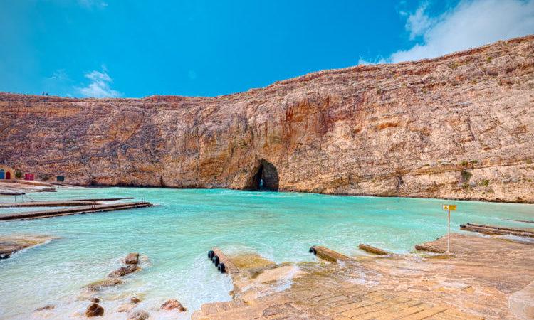 blue water in a bay in gozo