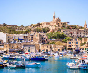 Beautiful view on Gozo island from a boat, postcard style, beautiful colors landscape, in the background you can see old buildings