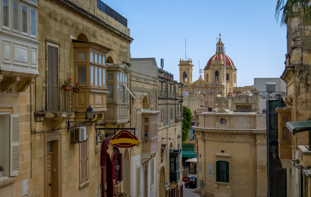 Victoria city street with Saint George Basilica red dome - Victoria, Gozo, Malta