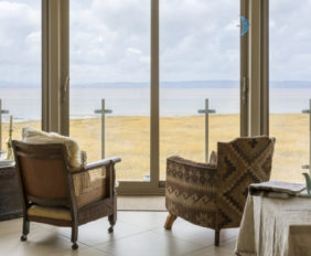 armchairs looking out to the coastal views - Woodhill Beach House, Somerset