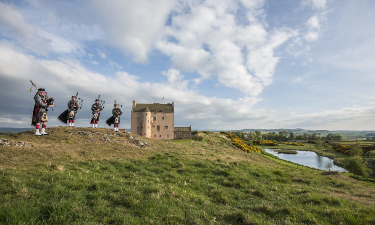 fenton tower bagpipers on hills