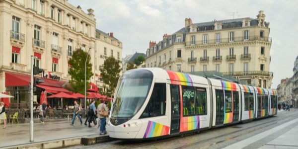 City tram with a rainbow flag emblem of LGBT in Anges, France